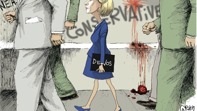 An image of the Feb. 13 cartoon by Glenn McCoy depicting U.S. Education Secretary Betsy DeVos being escorted into a school. The image has generated a flurry of comments on social media.