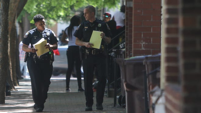 Wilmington police patrol the Eastside neighborhood on May 20. State lawmakers are providing $200,000 for patrols in the city.