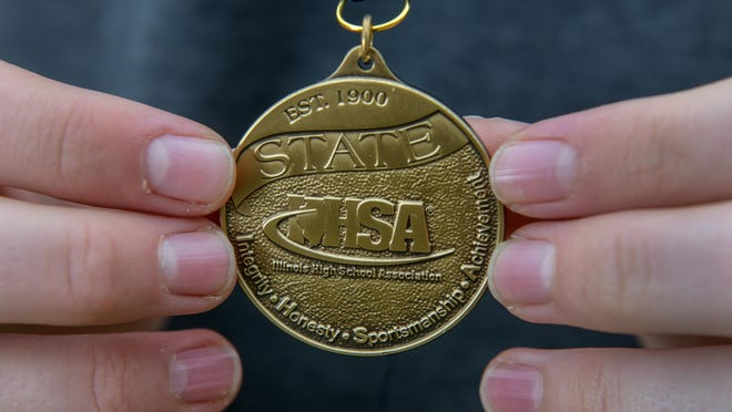 A look at an Illinois High School Association state championship medal.