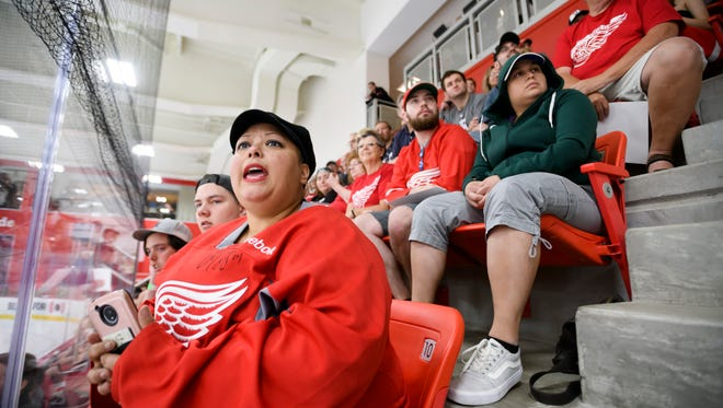 Jennifer Reed, of Grand Rapids, watches a recent Red Wings scrimmage from the stands at the practice arena at Little Caesars Arena.