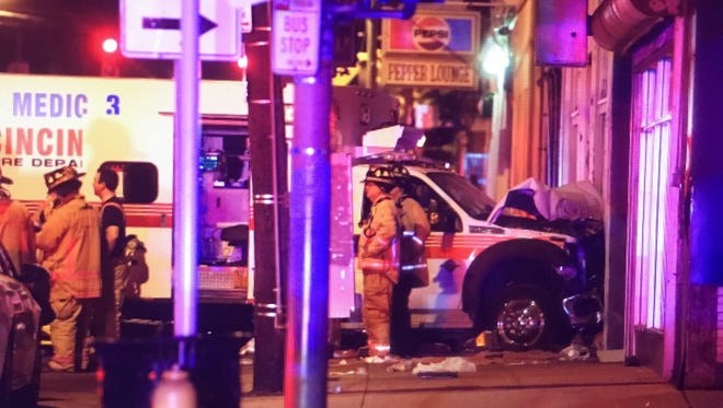 An ambulance carrying a shooting victim collided with a building on Vine Street Monday night.