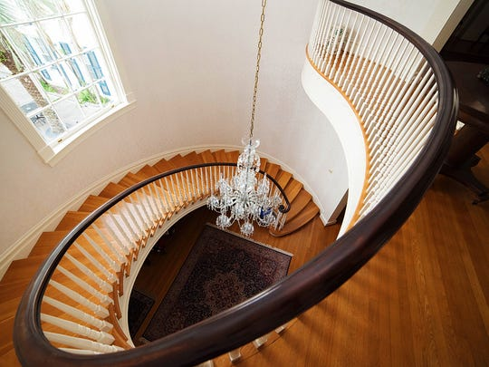 The winding staircase leads to the upstairs bedrooms and baths.