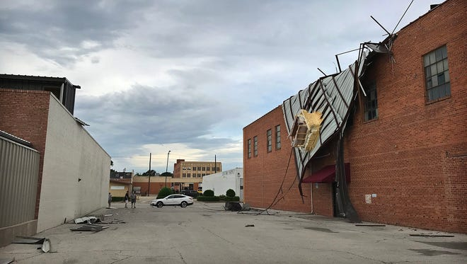 A metal roof from the building on the left was blown off and landed on the Fritz Building about 1:00 a.m. as storms moved through Wichita Falls Friday morning.