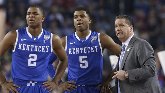 Aaron Harrison (2) and Andrew Harrison (5) are going to stay for another season with coach John Calipari.