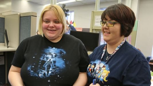 Katie Burris (left) and Evangeline Cook are all smiles after they walk away with their marriage license, at the Marion County Clerk's office in the City/County building, Monday. The U.S. Supreme Court denied requests to take up the same-sex marriage issue, meaning gay marriage is legal in Indiana.