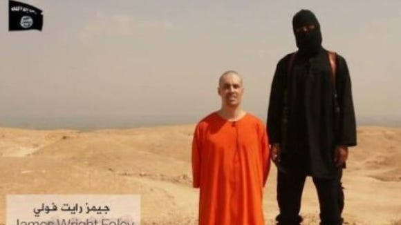 In a brutal video made public Tuesday, an Islamic militant appears to behead captured U.S. journalist James Foley.