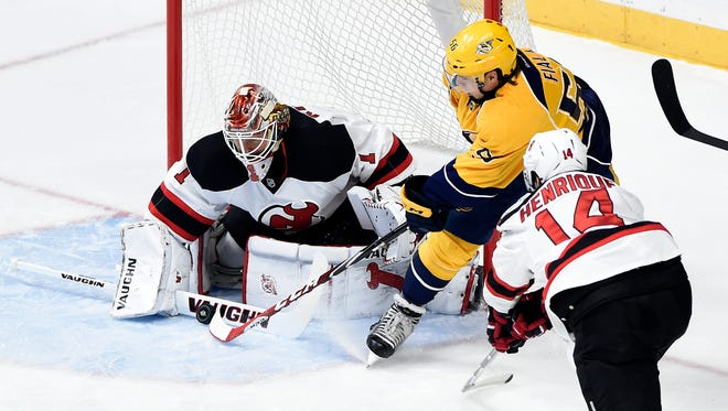 Devils goalie Keith Kinkaid (1) blocks a shot by Nashville Predators left wing Kevin Fiala (56) during the first period of a game Saturday in Nashville.