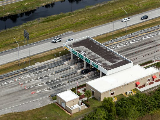 The Interstate 75 Alligator Alley toll booth has a lane for motorists with SunPass transponders, who don't have to stop to pay a toll.