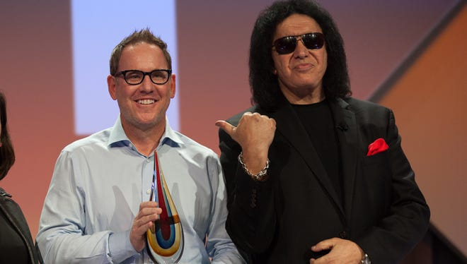 Sam Fox (middle) is founder of Fox Restaurant Concepts in Phoenix. He won a Hot Concepts Award from Nation's Restaurant News and was given the honor at a ceremony hosted by Gene Simmons of KISS, pictured on the right.