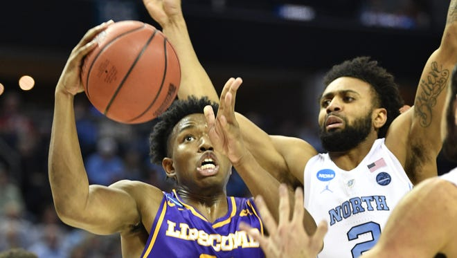 Lipscomb guard Kenny Cooper (21) goes up for a shot against North Carolina on Friday in the NCAA tournament.