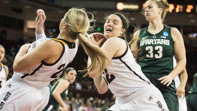 Arizona State forward Jamie Ruden, center, with Arizona State forward Kelsey Moos, left, grabs a rebound against Michigan State center Jenna Allen (33) during a first-round game in the women's NCAA college basketball tournament Friday, March 17, 2017, in Columbia, S.C.