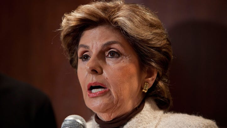 Attorney Gloria Allred speaks at a news conference with Bobby Davis and Mike Lang at the Renaissance Hotel in New York Times Square on December 13, 2011 in New York City. The men are being represented by Allred in a suit against Syracuse University, and its former assistant basketball coach Bernie Fine, for his alleged sexual molestation of Davis and Lang over twenty years ago.