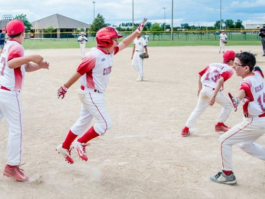 The Canton Cardinals jump for joy after capturing their