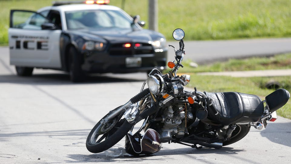Police investigate a car vs. motorcycle accident on