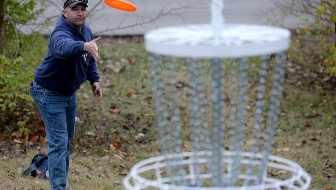"Ray Page plays disc golf Thursday, Nov. 12, 2015, at the new course named ""The Glen"" at Glen Miller Park in Richmond."