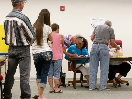 Voters line up on Tuesday inside the Bloomfield Municipal Complex. Voters approved a tax increase that will generate additional revenue for the city's operational costs.