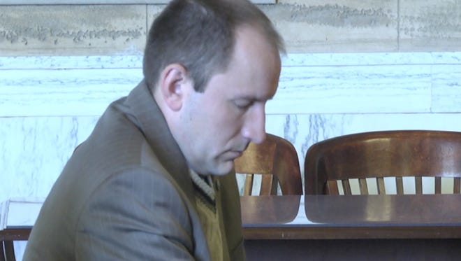 Former Dutchess County Legislator Michael Kelsey listens to closing arguments for his trial on May 11 in this screen capture.
