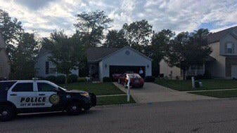 Police responded to a Hamilton home after two bodies were discovered by a family member on Tuesday.