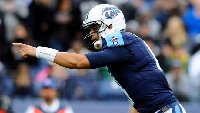 Nov 29, 2015; Nashville, TN, USA; Tennessee Titans quarterback Marcus Mariota (8) calls plays at the line during the first half against the Oakland Raiders at Nissan Stadium. Mandatory Credit: Christopher Hanewinckel-USA TODAY Sports