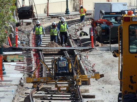 Workers install rails along Santa Fe Street near the intersection with Main Street last fall in Downtown El Paso. The state-funded streetcar project will run along a 4.8-mile loop. The project is being managed by the Camino Real Regional Mobility Authority for the city of El Paso.