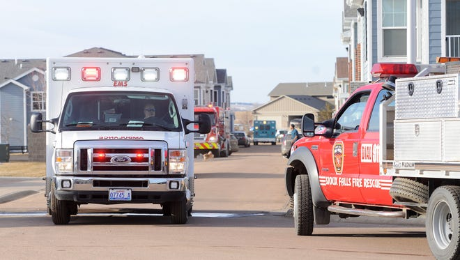 An ambulance leaves the scene of a shooting outside of an apartment on the 9400 block of W. Karmya Circle in southwestern Sioux Falls Friday, Feb 26, 2016. Police say a man shot a woman then turned the gun on himself.