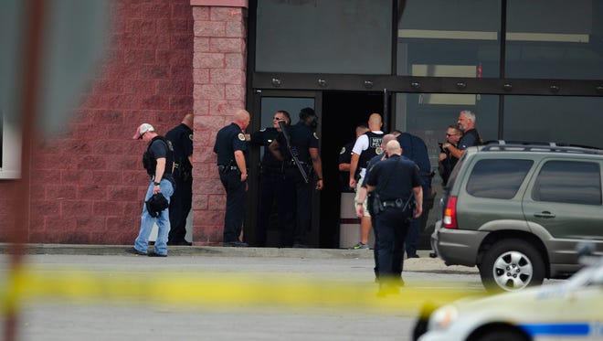 Police and fire work the scene from a reported shooting Carmike 8 movie theater in Nashville, Tenn. August 5, 2015.