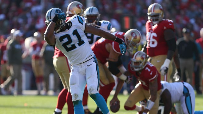 Carolina Panthers free safety Mike Mitchell (21) gestures to kiss his bicep after a sack against San Francisco 49ers quarterback Colin Kaepernick (7) during the second quarter at Candlestick Park in San Francisco  on Nov. 10, 2013.