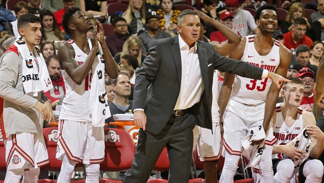 Ohio State coach Chris Holtmann reacts from the bench during a game against Wooster at Value City Arena on Nov. 5, 2017.