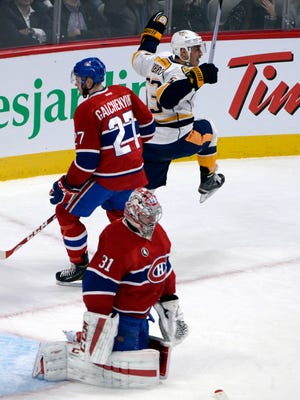 Nashville's Mike Ribeiro (63) celebrates after scoring the Predators' lone  goal against Montreal goalie Carey Price (31).