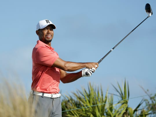 Tiger Woods watches his tee shot on the fourth hole during the Pro-Am at the Hero World Challenge golf tournament, Wednesday, Nov. 30, 2016, in Nassau, Bahamas. (AP Photo/Lynne Sladky)