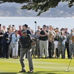 Clint Eastwood watches the flight of his ball during last year's 3M Celebrity Challenge at Pebble Beach Golf Links. Eastwood will be one of the 12 participants in next month's event.