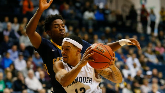 Monmouth Hawks guard Justin Robinson (12) drive to the basket against Canisius Golden Griffins guard Malik Johnson (1) during first half at  Ocean First Bank Center, West Long Branch,NJ. Sunday, December 4, 2016.                                                                            Noah K. Murray-Correspondent/Asbury Park PressASB 1205 Monmouth Basketball