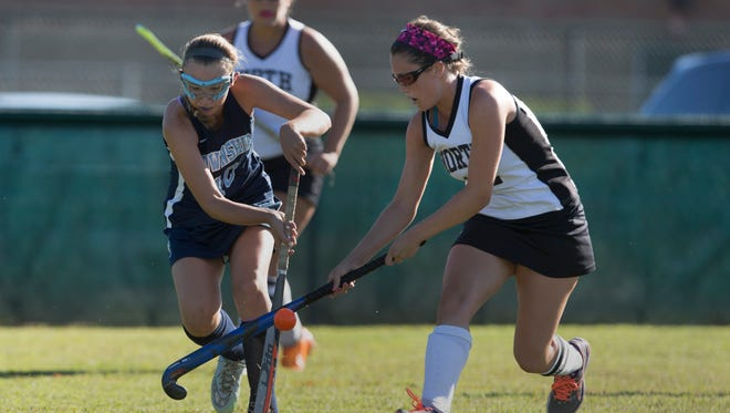 Freehold Townships Brit Tolmachowich battles Middletown North's Stephanie Kinsella for ball during first half action. Middletown North Field Hockey vs Freehold Township on September 16, 2016 in Middletown, NJ.