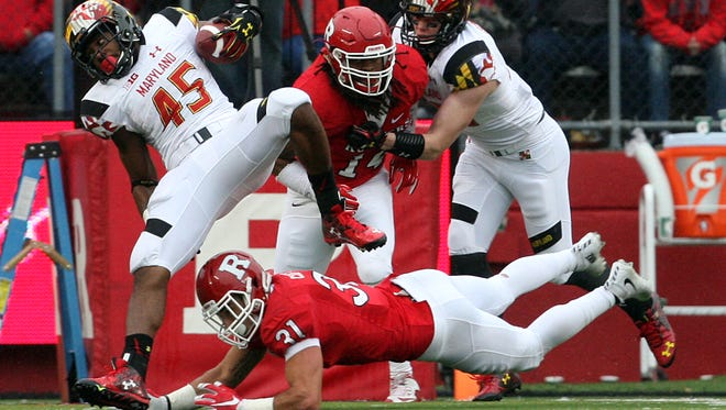 Anthony Cioffi tackles Maryland's Brandon Ross (#45) in last year's season finale.