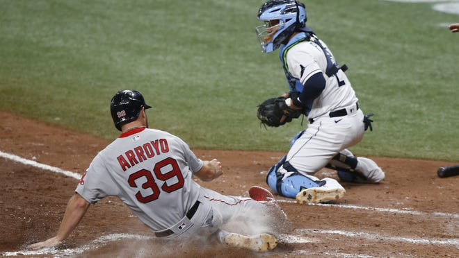 Boston's Christian Arroyo (39) slides home with a run Thursday night against the Rays.
