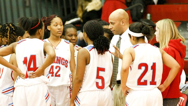 K.C. Keyton talks to his team during a game in 2009. He has been selected as Everett's new boys basketball coach.