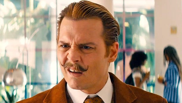 "Johnny Depp plays a roguish art dealer and bon vivant in ""Mortdecai."""