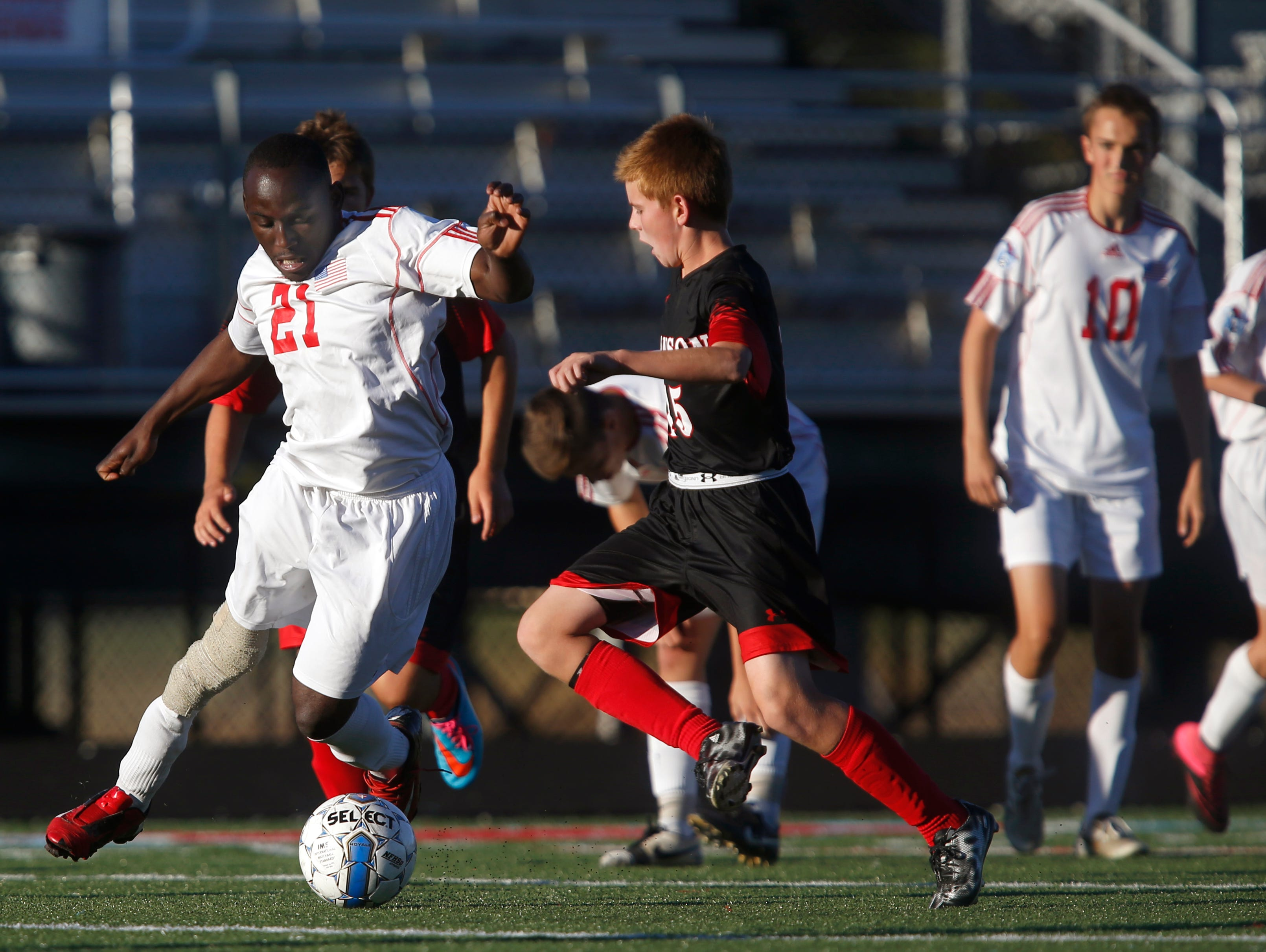 Glendale senior David Odun-Ayo competes for the ball during a soccer game against Branson on Tuesday, Oct. 13, 2015. Odun-Ayo, who was born with proximal femoral focal deficiency, and is missing part of his right leg, runs and walks with a prosthetic leg is playing organized soccer for the first time.