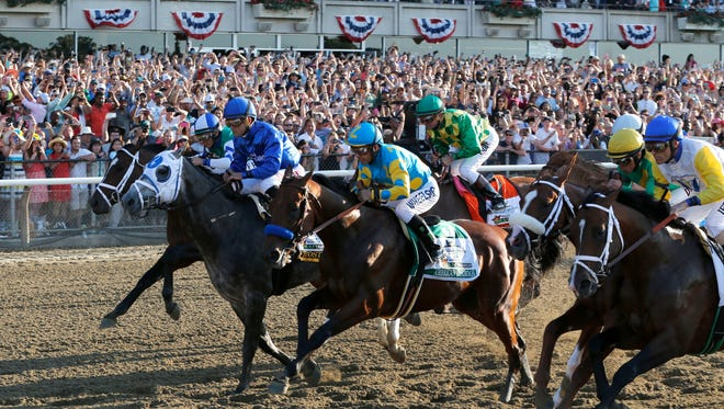 American Pharoah (5) with jockey Victor Espinoza up breaks out of the starting gate at the start of the 147th running of the Belmont Stakes horse race at Belmont Park, Saturday, June 6, 2015, in Elmont, N.Y. American Pharoah won the race to become the first horse to win the Triple Crown in 37 years.