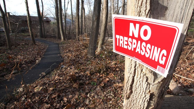 An illegally paved walk-way from Neva Court to Quince Lane in the Town of Ramapo on Friday, Nov. 27, 2015.