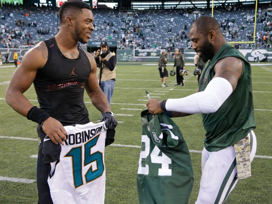 Jets cornerback Darrelle Revis, right, trading jerseys with Jaguars receiver Allen Robinson after a game last season. The trend has become a popular one around the league.