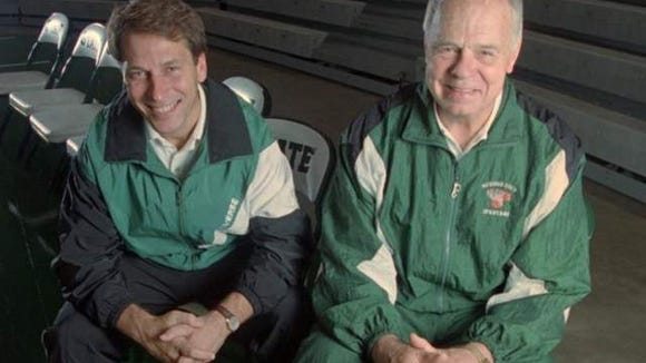 Former Michigan State coach Jud Heathcote (right) poses