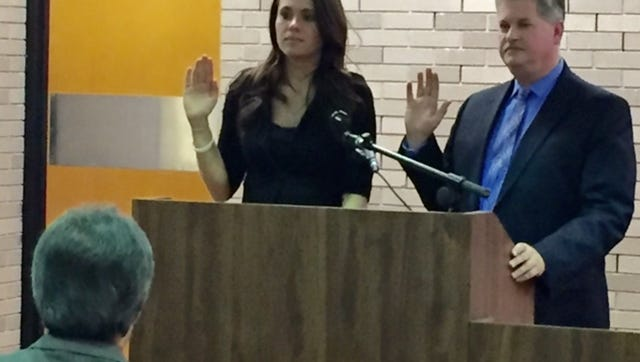 Amanda Mazzoni, of Vineland, and Thomas M. Corrigan, of Bridgeton, are administered the oath of office Tuesday night. The two became the city's part-time municipal attorneys.