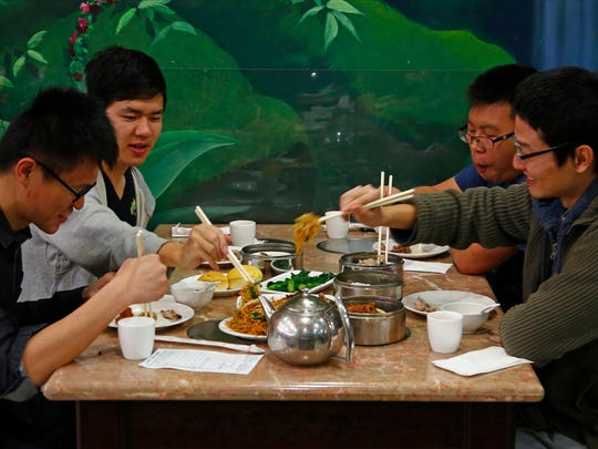 Patrons gather and eat at Mekong Palace on Feb. 19,