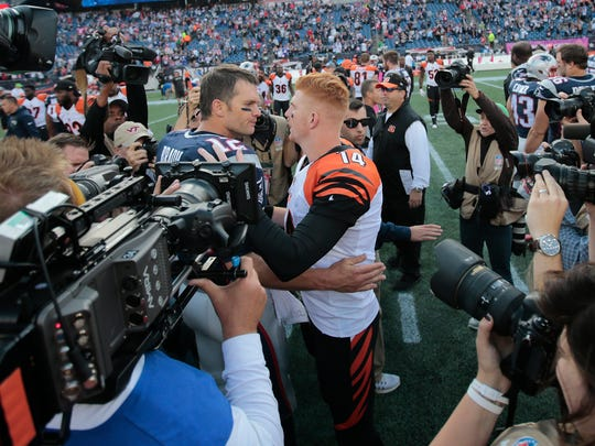 Cincinnati Bengals quarterback Andy Dalton (14) and New England Patriots quarterback Tom Brady (12) shake hands after the Week 6 NFL football game between the Cincinnati Bengals and New England Patriots, Sunday, Oct. 16, 2016, at Gillette Stadium in Foxborough, Mass. The New England Patriots won 35-17 and the Bengals fall to 2-4 on the season.