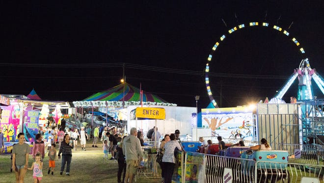 The Sumner County Fair lights up the night at the Sumner County Fairgrounds in Gallatin on Thursday, July 12.
