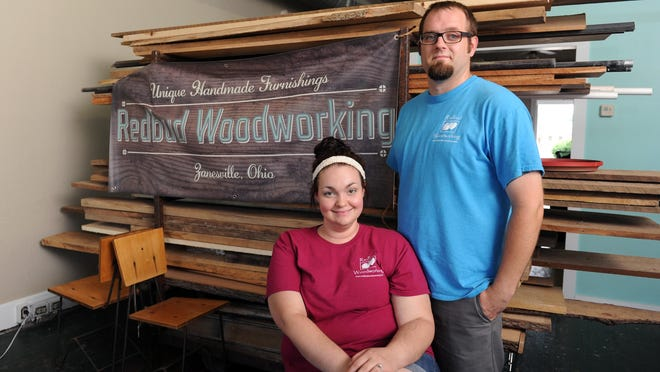 Emily and Curt Bellville, owners of Redbud Woodworking, pose for a photo at their new business at 53 N. Fourth St. in downtown Zanesville.