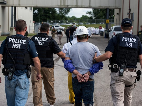 Officers arrested 146 immigrants who are in the country illegally during a raid Tuesday at a meat-packing plant in Salem, Ohio.