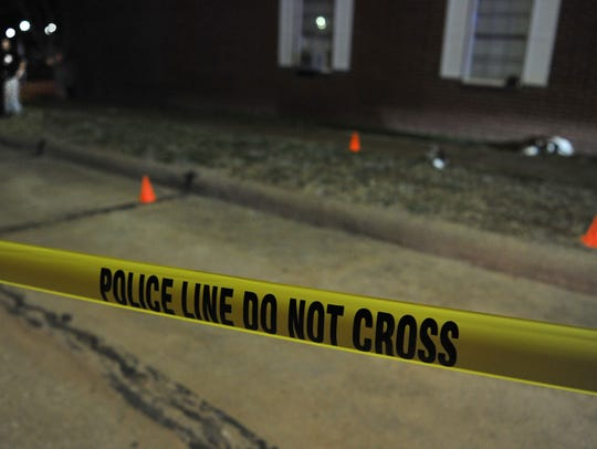 Wichita Falls police investigate the scene of a double shooting at the Plantation Apartments, 1201 Austin St., Monday night.