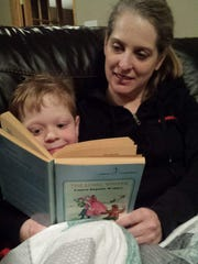 """Melissa Godber reads """"The Long Winter"""" by Laura Ingalls Wilder to her son, Jesse, 5."""